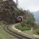 Toy train coming trough a tunnel
