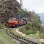 Toy train coming trough a tunnel in Shoghi