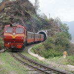 Toy train coming trough a tunnel near Shimla